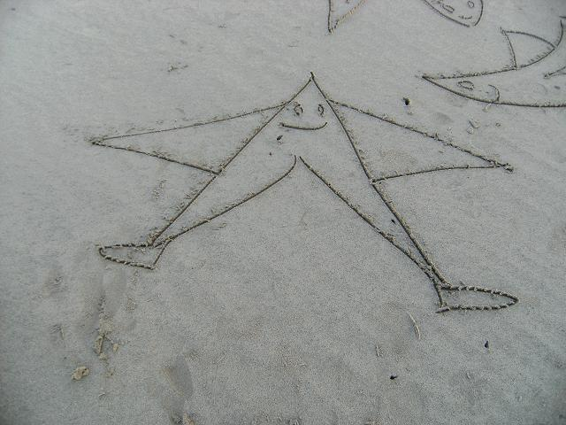 Sand Drawing and Standing Stone Images Beach Art Images